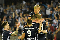 Melbourne, December 8, 2018 - Keisuke Honda of Melbourne Victory celebrates a goal by OLA TOIVONEN (11) with his teammates in the round seven match of the A-League between Melbourne Victory and Adelaide United at Marvel Stadium, Melbourne, Australia.