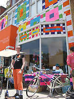 Michelle with her Go-Ped Know-Ped kick scooter standing in front of the Craft and Folks Art Museum, the front of which was covered by hundreds of croched squares.  Taken during the June 23, 2013 CicLAvia event, where miles of Wilshire Blvd. were closed to car traffic.