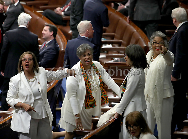 Democratic Women members point to the gallery where their guests are seated prior to United States President Donald J. Trump delivering his second annual State of the Union Address to a joint session of the US Congress in the US Capitol in Washington, DC on Tuesday, February 5, 2019. Photo Credit: Alex Edelman/CNP/AdMedia