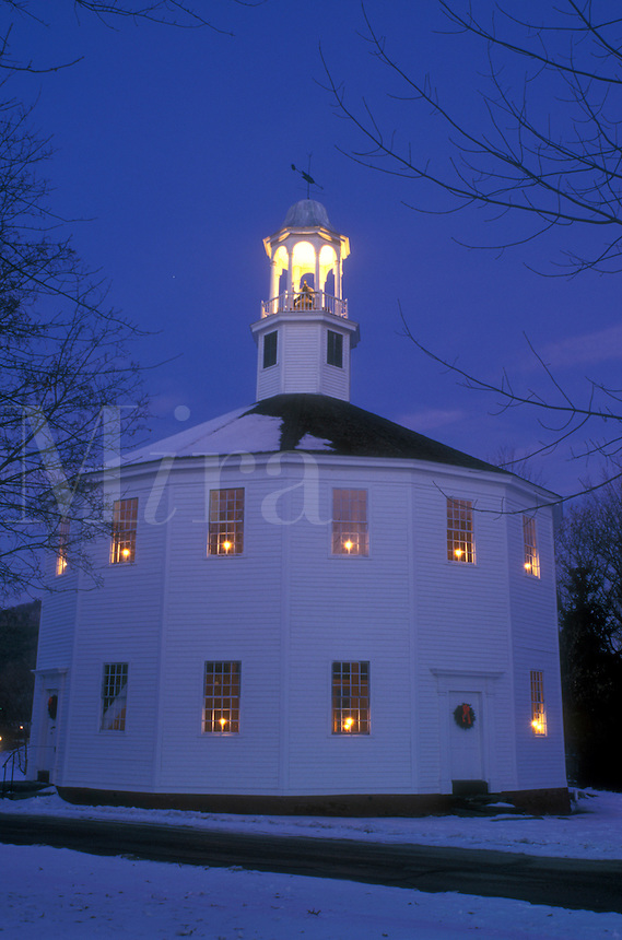 AJ5845, church, Christmas, chapel, round church, winter, decorations, snow, holiday, Vermont, Candles in the windows decorate the Old Round Church (a 16-sided polygon) National Historical Landmark for the Christmas holiday season at night in Richmond in Chittenden County in the state of Vermont.
