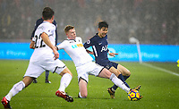 Sam Clucas of Swansea City & Son Heung-Min of Spurs during the Premier League match between Swansea City and Tottenham Hotspur at the Liberty Stadium, Swansea, Wales on 2 January 2018. Photo by Mark Hawkins / PRiME Media Images.
