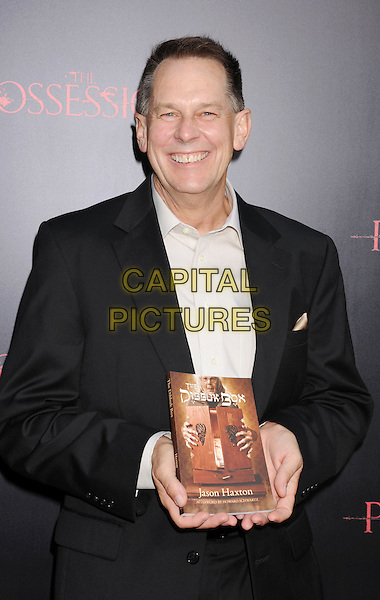 "Jason Haxton.""The Possession"" Los Angeles Premiere held at Arclight Cinemas, Hollywood, California, USA..August 28th, 2012.half length suit book black white shirt.CAP/ROT/TM.©Tony Michaels/Roth Stock/Capital Pictures"