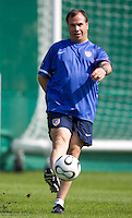 USA's head coach Bruce Arena kicks the ball  during practice in Hamburg, Germany, for the 2006 World Cup, June, 9, 2006.