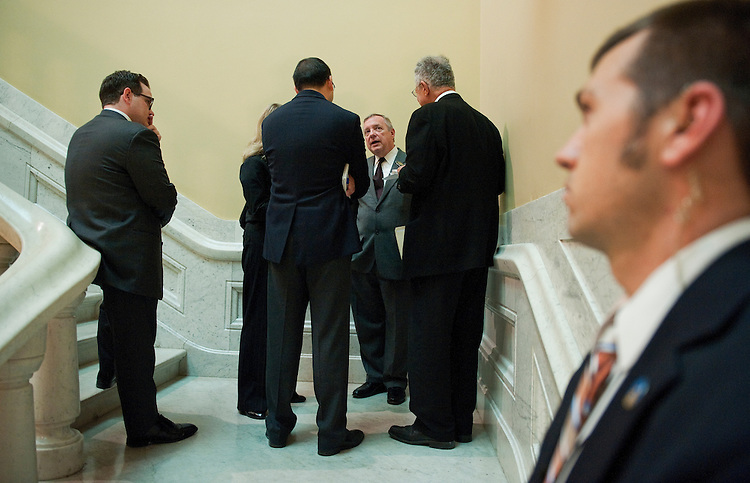 UNITED STATES - NOVEMBER 01:  Senate Majority Whip Richard Durbin, D-Ill., center, speaks with reporters after a news conference in the Capitol where he and other Senators introduced campaign finance reform legislation.  (Photo By Tom Williams/CQ Roll Call)