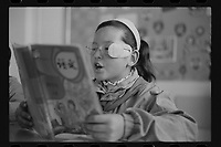 Jeminay County, Xinjiang Uygur Autonomous Region, China - A primary student reads in class, October 2019.