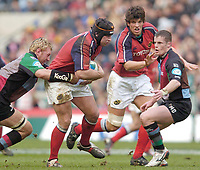 2004/05 Heineken_Cup, NEC,Harlequins vs Munster, RFU Twickenham,ENGLAND:.Munster's, Dennis Leamy, with the ball, breaking through Karl Rudzki's tackle as Mel Deane run's to support, Donnacha O'Callaghan run's beside..Photo  Peter Spurrier. .email images@intersport-images.com...