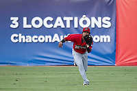 Frisco Roughriders outfielder Teodor Martinez (3) makes a running catch in the outfield during the Texas League baseball game against the San Antonio Missions on August 22, 2013 at the Nelson Wolff Stadium in San Antonio, Texas. Frisco defeated San Antonio 2-1. (Andrew Woolley/Four Seam Images)
