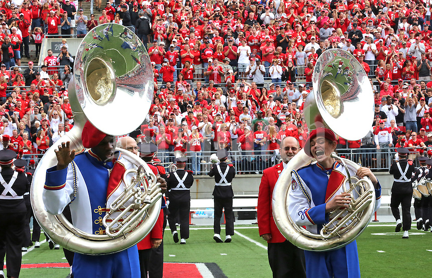 "(from R) Billy Brandon and Boniface Womber, members of the Ohio State School for the Blind Marching Band Sousaphone section, have a laugh during the halftime performance of The Ohio State University Marching Ban at Ohio Stadium in Columbus, Ohio on September 21, 2013. The Band spelled out ""Ohio"" in braille while the OSU band performed ""Script Ohio"". (Columbus Dispatch photo by Brooke LaValley)"