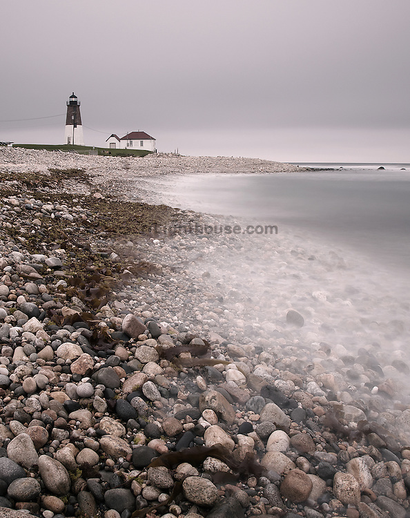 Misty waves wash ashore at Point Judith Lighthouse