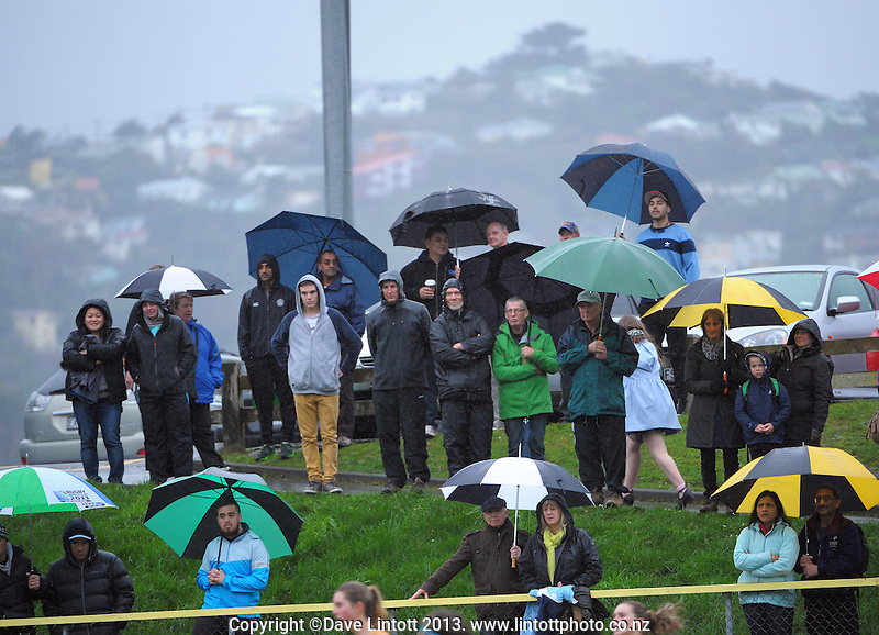 Fans brave the weather to watch the women's National Hockey League hockey match between Capital women and Southern at National Hockey Stadium, Wellington, New Zealand on Sunday, 11 August 2013. Photo: Dave Lintott / lintottphoto.co.nz