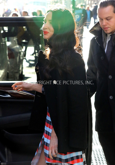 WWW.ACEPIXS.COM<br /> <br /> January 13 2016, New York City<br /> <br /> Actress Olivia Munn wears a tummy exposing summer dress as she jumps into a car in Soho on January 13 2016 in New York City<br /> <br /> By Line: Zelig Shaul/ACE Pictures<br /> <br /> <br /> ACE Pictures, Inc.<br /> tel: 646 769 0430<br /> Email: info@acepixs.com<br /> www.acepixs.com