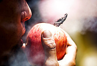 A man smokes marijuana in a apple during a demonstration in support for legalization of marijuana in Bogota, May 4, 2013. Photo by Freddy Builes / VIEWpress.