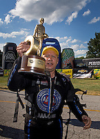 Sept. 2, 2013; Clermont, IN, USA: NHRA funny car driver Robert Hight celebrates after winning the US Nationals at Lucas Oil Raceway. Mandatory Credit: Mark J. Rebilas-