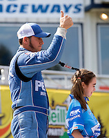 Aug. 4, 2013; Kent, WA, USA: NHRA top fuel dragster driver T.J. Zizzo and his daughter during the Northwest Nationals at Pacific Raceways. Mandatory Credit: Mark J. Rebilas-USA TODAY Sports