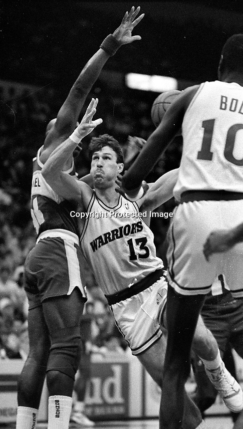 Warrior Sarunas Marciulions against Seattle..(1990 photo/Ron Riesterer)