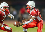 Lawndale, CA 09/26/14 - Austin Manigo (Lawndale #7) and Chris Murray (Lawndale #12) in action during the Palos Verdes Peninsula vs Lawndale CIF Varsity football game at Lawndale High School.  Lawndale defeated Peninsula 42-21