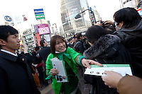 A woman supporter hands out leaflets for former Prime-Minsters of Japan, Morihiro Hosokawa and Junichiro Koizumi while they are campaigning for the 2014 Tokyo Gubernatorial elections in Shibuya, Tokyo, Japan. Friday February 7th 2014