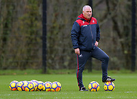 Nigel Gibbs, assistant coach observes the players rain during the Swansea City Training at The Fairwood Training Ground, Swansea, Wales, UK. Wednesday 22 November 2017