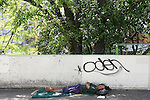 May 5, 2010 - Tokyo, Japan - A homeless man sleeps in a street of Tokyo, Japan, on May 5, 2010. Homelessness  increased sharply due to the rise in unemployment in the 1990s. In Tokyo alone, some 2,600 people are now officially listed as homeless - although charities say the number is more likely to be two to three times that figure.