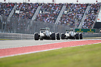 Nico Rosberg of Mercedes AMG Petronas F1 driving (6) Mercedes F1 WO5 Hybrid is followed by Lewis Hamilton of Mercedes AMG Petronas F1 driving (44) F1 WO5 Hybrid during 2014 Formula 1 United States Grand Prix race, Sunday, November 02, 2014 in Austin, Tex. (Mo Khursheed/TFV Media via AP Images)