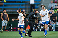 Seattle, Washington -  Sunday, September 11 2016: Seattle Reign FC head coach Laura Harvey laughs with Seattle Reign FC midfielder Keelin Winters (11) prior to a regular season National Women's Soccer League (NWSL) match between the Seattle Reign FC and the Washington Spirit at Memorial Stadium. Seattle won 2-0.