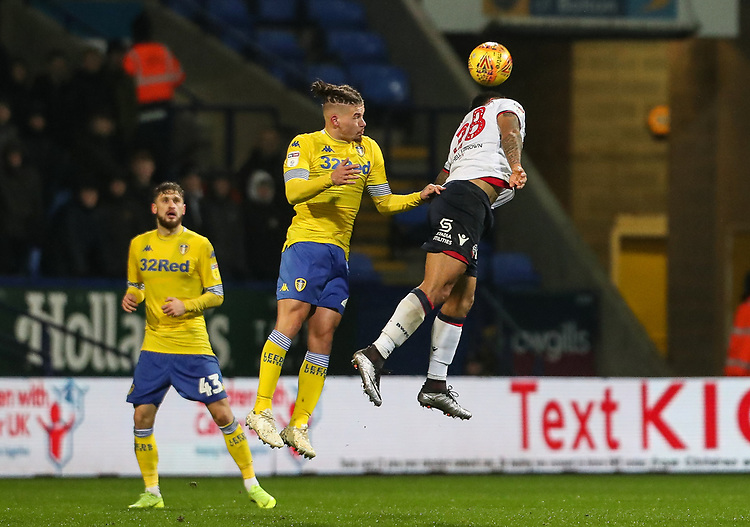Bolton Wanderers' Josh Magennis heads under pressure from Leeds United's Kalvin Phillips<br /> <br /> Photographer Andrew Kearns/CameraSport<br /> <br /> The EFL Sky Bet Championship - Bolton Wanderers v Leeds United - Saturday 15th December 2018 - University of Bolton Stadium - Bolton<br /> <br /> World Copyright © 2018 CameraSport. All rights reserved. 43 Linden Ave. Countesthorpe. Leicester. England. LE8 5PG - Tel: +44 (0) 116 277 4147 - admin@camerasport.com - www.camerasport.com