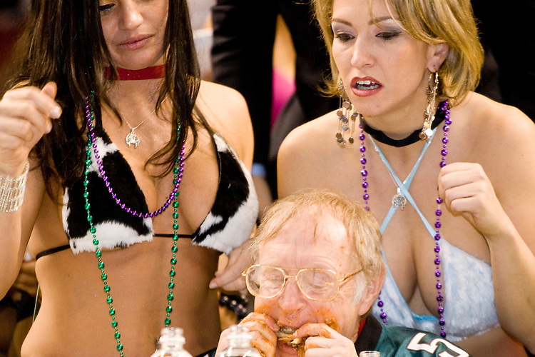 Professional eater Rich LeFevre aka &quot;The Locust&quot; at the 14th annual Wing Bowl, held in Philadelphia on February 3, 2006 at the Wachovia Center.<br /> <br /> The Wing Bowl is a competitive eating event in which eaters try and down the most hot wings in 30 total minutes in front of a crowd of 10,000 plus people.  The real show however is all around the eaters, from the various scantily clad women (known as &quot;Wingettes&quot;) that make up eaters' entourages, to the behavior of the fans themselves.