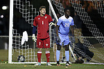 CARY, NC - NOVEMBER 19: UNCW's Ryan Cretens (1) and North Carolina's Jelani Pieters (26). The University of North Carolina Tar Heels hosted the UNCW Seahawks on November 19, 2017 at Koka Booth Stadium in Cary, NC in an NCAA Division I Men's Soccer Tournament Second Round game. UNC won the game 2-1.
