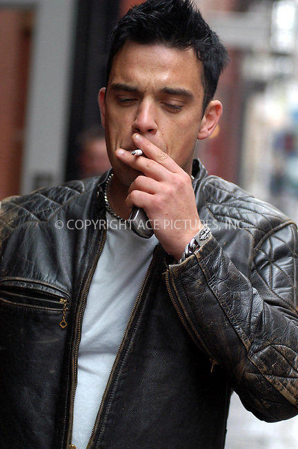 British pop star Robbie Williams seems to be spending more time outside his hotel than inside. Robbie was seen smoking, fooling around with his companions and meeting friends in the streets of SoHo. New York, May 9, 2003. Please byline: NY Photo Press.   ..*PAY-PER-USE*      ....NY Photo Press:  ..phone (646) 267-6913;   ..e-mail: info@nyphotopress.com