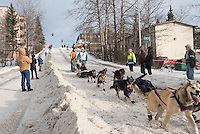Jessie Royer and team run past spectators on the bike/ski trail with an Iditarider in the basket during the Anchorage, Alaska ceremonial start on Saturday, March 5, 2016 Iditarod Race. Photo by O'Hara Shipe/SchultzPhoto.com