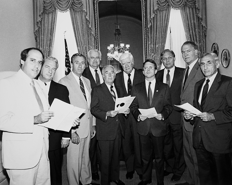 """Mazzoki, Rep. Robert William Kastenmeier, D- Wis., Richard Michael """"Mike"""" DeWine, R- Ohio, Attorney General of Ohio, Speaker of the House, Rep. Thomas Phillip """"Tip"""" O'Neill, Rep. Peter Wallace Rodino, D-N.J., House Judiciary Committee Chairman, Rep. Henry John Hyde, R- Ill., House Committee on International Relations Chairman, Huger, Kinoness, Rep. Daniel Robert """"Dan"""" Glickman, D-Kans., Chairman and CEO of the Motion Picture Association of America stand together. (Photo by CQ Roll Call)"""