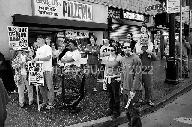 Los Angeles, California.USA.March 17, 2007..People watch demonstrators march through Hollywood protesting the fourth anniversary of the war in Iraq.