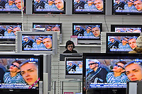 Moscow, Russia, 02/12/2006.&amp;#xA;Customers inspect the hundreds of televisions on display on the first day of trading at the first Moscow branch of the German owned Media Markt electronics store. Media Markt is the largest consumer electronics retailer in Europe, and the store opened at 7.00 am to cope with anticipated demand.<br />