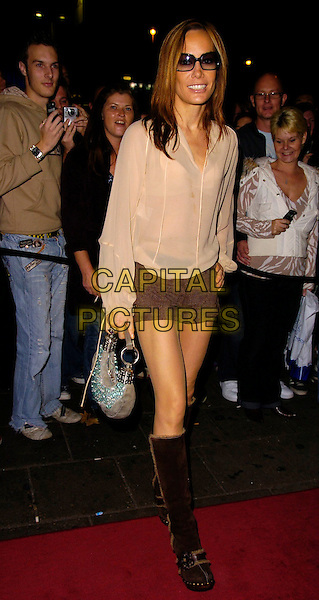 TARA PALMER TOMKINSON.The Sugababes new album launch & concert at the Dominion Thatre, London, UK..October 29th, 2006.Ref: CAN.full length brown boots shorts sheer beige top sunglasses shorts silver bag purse.www.capitalpictures.com.sales@capitalpictures.com.©Can Nguyen/Capital Pictures