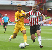 Preston North End's Callum Robinson battles with  Sheffield United's Jack O'Connell<br /> <br /> Photographer Mick Walker/CameraSport<br /> <br /> The EFL Sky Bet Championship - Sheffield United v Preston North End - Saturday 22 September 2018 - Bramall Lane - Sheffield<br /> <br /> World Copyright &copy; 2018 CameraSport. All rights reserved. 43 Linden Ave. Countesthorpe. Leicester. England. LE8 5PG - Tel: +44 (0) 116 277 4147 - admin@camerasport.com - www.camerasport.com