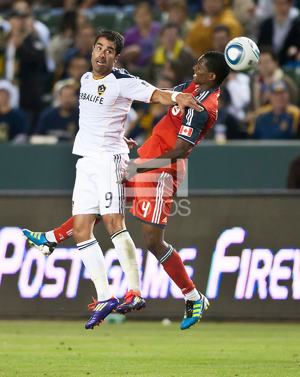 CARSON, CA – June 11, 2011: LA Galaxy forward Juan Pablo Angel (9) and Toronto FC defender Doneil Henry (4) during the match between LA Galaxy and Toronto FC at the Home Depot Center in Carson, California. Final score LA Galaxy 2, Toronto FC 2.