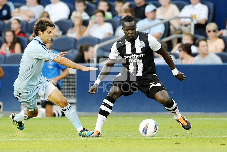 CheikTiote (black& white) Newcastle United midfielder waiting for the challenge from Graham Zusi Sporting KC... Sporting Kansas City and Newcastle United played to a scoreless tie in an international friendly at LIVESTRONG Sporting Park, Kansas City, Kansas.