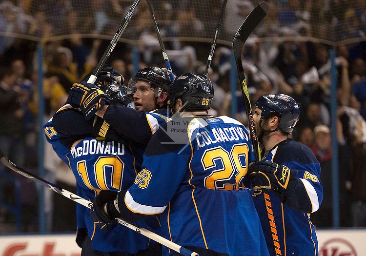 April 19 2009       Blues players celebrate Andy McDonald's goal in the second period.  The St. Louis Blues hosted the Vancouver Canucks in the third playoff game between the two teams on Sunday April 19, 2009 at the Scottrade Center in downtown St. Louis, MO.  The Blues entered the game down 2-0 in the best of seven series.  ..            *******EDITORIAL USE ONLY*******