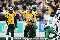 October 31, 2009; Hamilton, ON, CAN;  Hamilton Tiger-Cats defensive end Garrett McIntyre (71) celebrates recovering a Saskatchewan Roughriders fumble. CFL football: Saskatchewan Roughriders vs. Hamilton Tiger-Cats at Ivor Wynne Stadium. The Tiger-Cats defeated the Roughriders 24-6. Mandatory Credit: Ron Scheffler. Copyright (c) 2009 Ron Scheffler.