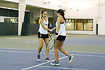 Eliza Omirou (left) of the Wake Forest Demon Deacons slaps hands with her doubles partner Alexis Franco during the match against the Liberty Flames at the Wake Forest Indoor Tennis Center on March 11, 2017 in Winston-Salem, North Carolina. The Demon Deacons defeated the Flames 7-0.  (Brian Westerholt/Sports On Film)