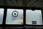 Ice covers the navigation window the Arctic expedition ship, Akademik Shokakskiy. The ship was forced to take shelter in a bay during a storm off Baffin Island, Nunavut, Canada.