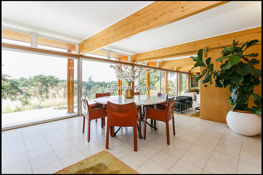BNPS.co.uk (01202 558833)<br /> Pic: Savills/BNPS<br /> <br /> The open plan design is full of light...<br /> <br /> Perfect home for a Bond villan...designed by a Bond villan!<br /> <br /> This stunning 1960's modernist masterpiece near Windlesham in Surrey was actually designed by Hungarian architect Erno Goldfinger - who bizarrely author Ian Fleming had based one of his most notorious James Bond villans on.<br /> <br /> Fleming was furious with Goldfinger after the architect had demolished his Hampstead cottage to make way for a modernist development before the war.<br /> <br /> But at £3 million you may need your own gold reserves to afford the stunning grade two listed home, and with 4 acres of grounds an 'Oddjob' man may come in handy to look after it.
