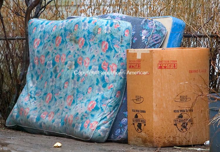WATERBURY, CT. 12 April 2007-041207SV12--Mattresses sit in a yard on Pine Street in Waterbury.<br /> Steven Valenti Republican-American