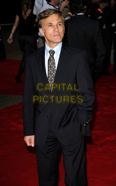 CHRISTOPH WALTZ.UK Premiere of 'Inglourious Basterds' at the Odeon, Leicester Square, London, England. .July 23rd, 2009.half length black suit jacket hand in pocket .CAP/CAN.©Can Nguyen/Capital Pictures.