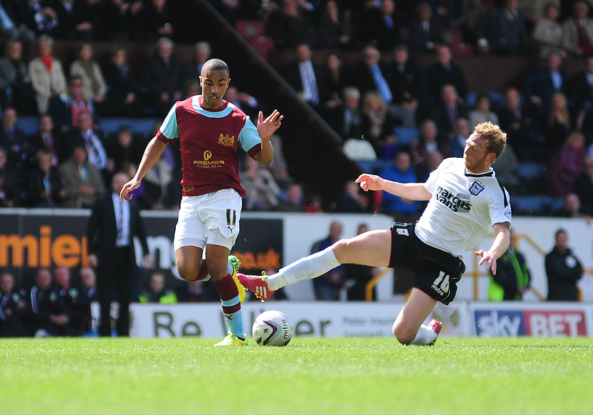 Burnley's Junior Stanislas vies for possession with Ipswich Town&rsquo;s Paul Green <br /> <br /> Photo by Chris Vaughan/CameraSport<br /> <br /> Football - The Football League Sky Bet Championship - Burnley v Ipswich Town - Saturday 26th April 2014 - Turf Moor - Burnley<br /> <br /> &copy; CameraSport - 43 Linden Ave. Countesthorpe. Leicester. England. LE8 5PG - Tel: +44 (0) 116 277 4147 - admin@camerasport.com - www.camerasport.com