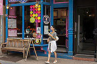 """A woman buys a Tasti D-Lite frozen yogurt on Bedford Avenue during """"Williamsburg Walks: Rethink Your Public Space"""" in the trendy hipster Williamsburg neighborhood of Brooklyn in New York on Saturday, June 8, 2013. The Dept. of Transportation closes several blocks in various neighborhoods for street activity where tables and chairs (and grass lawns) are set out and merchants vend their wares on the streets. © Richard B. Levine)"""