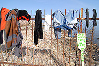 Mitilini / Lesbos / Greece 060416<br /> Clothes put to dry in the sun.<br /> In Mitilini beach are living 300 refugees of <br /> different nationalities coming by boat thru Turkey.<br /> Photo Livio Senigalliesi