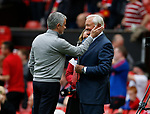 Jose Mourinho manager of Manchester United greets former manager Ron Atkinson during the English Premier League match at the Old Trafford Stadium, Manchester. Picture date: May 21st 2017. Pic credit should read: Simon Bellis/Sportimage