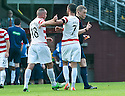Hamilton's Darian MacKinnon is held back by Dougie Imrie after he is sent off by referee John Beaton.