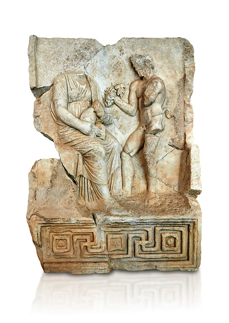 Roman Sebasteion relief  sculpture of Nysa and baby Dionysus Aphrodisias Museum, Aphrodisias, Turkey.     Against a white background.<br /> <br /> The nymph Nysa has the baby Dionysus on her lap. He reaches out to a bunch of grapes held up by a satyr, one of his woodland followers. Dionysus was the son of Zeus by Semele, and was given the nymphs of Mt Nysa for an upbringing in the wilds, safe from the eyes of Hera, Zeus's wife. Nysa was located in the Meander Valley, near Aphrodisias: the story was local.
